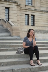 Woman talking on mobile phone in the city