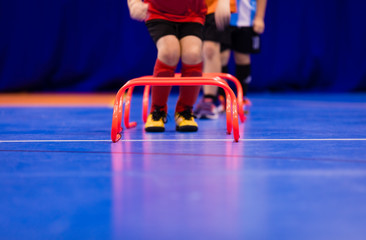 Futsal jumping drills. Futsal indoor soccer training session. Young futsal players exercising for agility and coordination