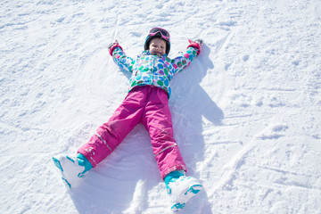 little girl  in ski resort
