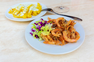Spanish tapas, fried shrimps and fried potato chips and aioli