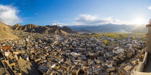Panorama view of Leh city in autumn and mountain in background. The capital of Ladakh, Northern India. Cityscape with sunlight view from Leh palace