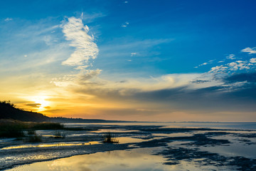 The sea and the beautiful expanse of blue sky with clouds and sunlight at sunset. Russia Azov sea.