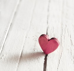 Red heart on the wooden background. Valentines Day.