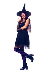 Image of smiling witch brunette in black dress and hat