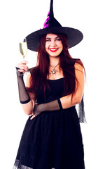 Photo of happy witch with wine glass with wine in black dress and hat