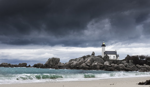 Small lighthouse on a stormy day on the wild coasts of Atlantic ocean in Guisseny, Brittany, France