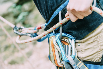 Female climber belaying with rope and figure eight.