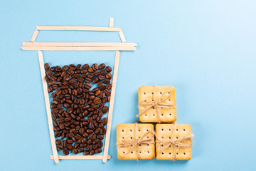 creative coffee on a blue background with cookies