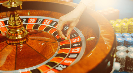 Female hand roulette in casino selective focus