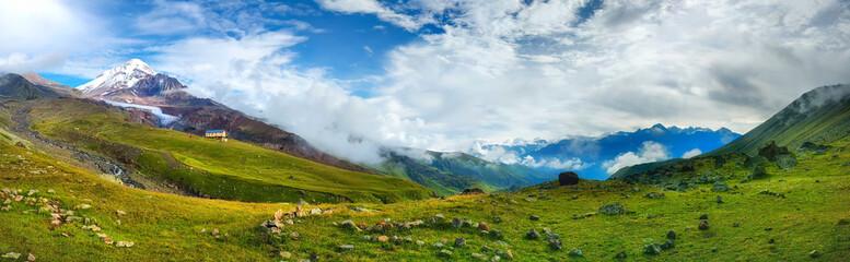 Panoramic view on Caucasus mountains with Kazbek mount peak