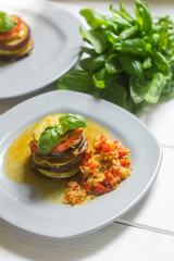 healthy vegetarian french ratatouille on white wooden background