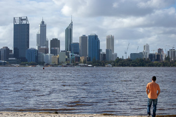 Cityscape of Perth with a guy with orange shirt