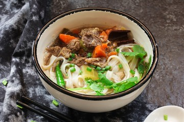 Pho Vietnamse Noodle Soup served in a bowl