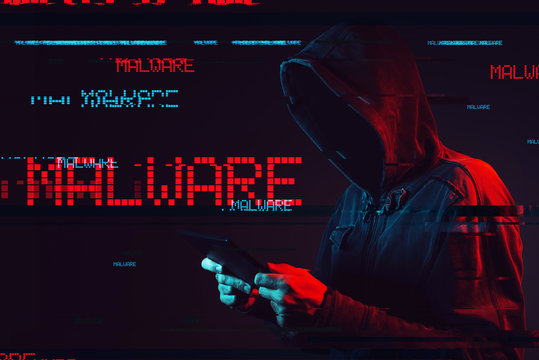 Malware concept with faceless hooded male person