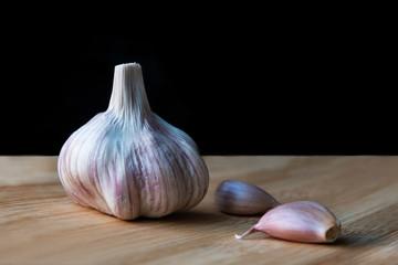 Organic garlic on wooden background.