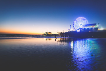 View of historic Santa Monica pier, with beach, amusement park, shops and restaurants, Los-Angeles, California, United States of America