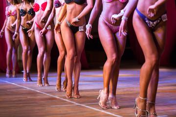 Side view of beautiful girls in bikini bottom to compete in a fitness bikini