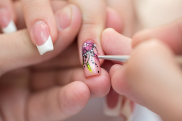 Closeup shot man making manicure to woman in beauty salon