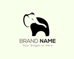 stand elephant with head in negative space logo design inspiration