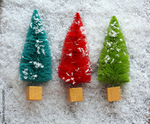 Christmas Tree Top View.Three Colorful Christmas Trees In Snow Top View Stock