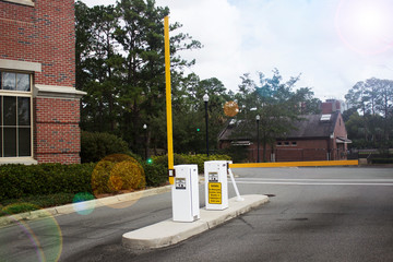 Yellow security parking gate with sun flare effect filter