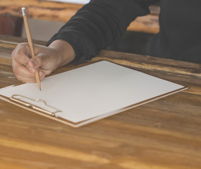 Lady holding pen, it's like a letter writer. Creative idea of work 2019 goals, writing, drawing,making notes in document.Business,investment,concept,Vintage ,Retro natural mood style. soft focus.