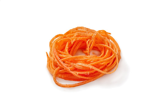sweet potato vegetable noodles. spiralized sweet potato. isolated on white background.
