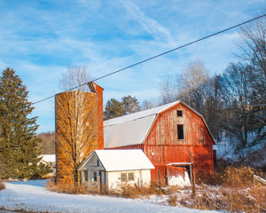 old barn and silo in winter