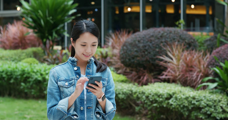 Woman speak to mobile phone in city