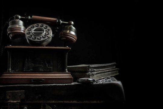 Vintage background. Old telephone and books.