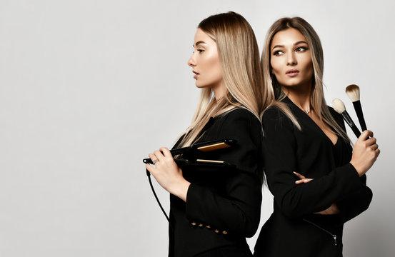 Two young beautiful european makeup artists friends or girlfriends women in dresses