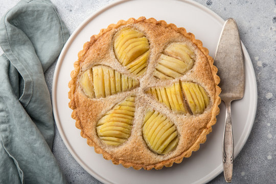 poached pear and almond frangipane tart