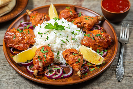 Chicken cooked in a Tandoori oven with basmati rice.