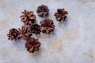 Florist decorator making Christmas wreath handmade on a white table. Women's hobby. Preparations for the holidays concept.DIY Christmas wreath with pinecones.resh and all natural materials.copy space