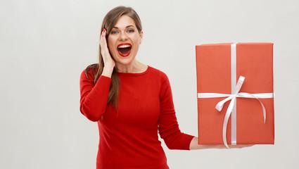 surprising woman holding big gift box.