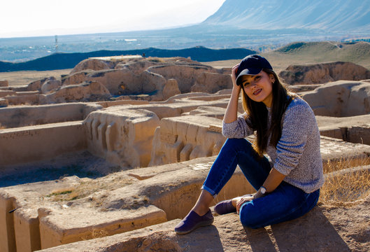 a young lady posing on the hill near the ancient Parthian (Iranian) capital Nisa
