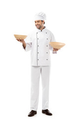 handsome young chef holding bowls isolated on white