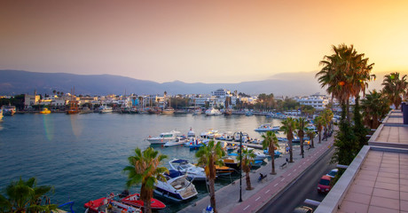 Wall Mural - The capital of the island of Kos, Greece, view of the city and marina at sunset, a popular destination for travel in Europe