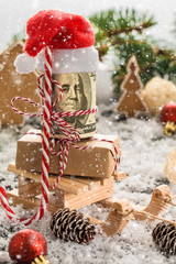 Money Christmas Gift with wooden sled. Christmas concept.