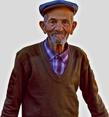 close-up portrait of senior man looking at camera with isolated background. Elderly Turkish Man Portrait who lives in a small town of Turkey.