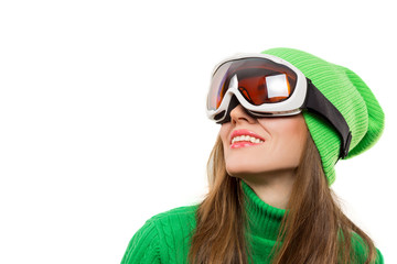 Active young ski woman portrait wearing winter clothing isolated over white