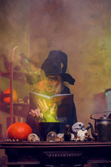 Photo of witch on cauldron with steam