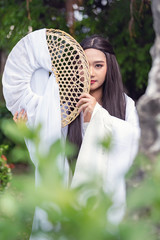 Close up portrait Beautiful Chinese woman white dress traditional, Beautiful and belligerent face; asian you woman in Chinese dress.