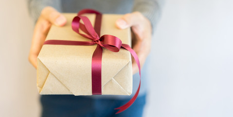 close up man hand holding gift box for happy new year and christmas concept