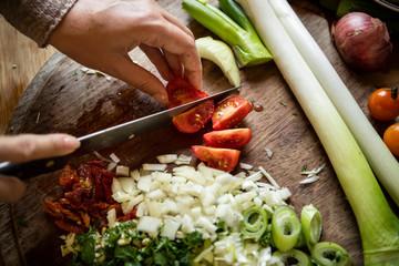 Woman cutting tomatoes on a cutting board