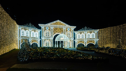 Beautiful and dreamlike winter wonderland night scenic. Illumination light up decoration ready for Christmas season and Happy New year celebration. Dazzling and sparkling mansion with garden.
