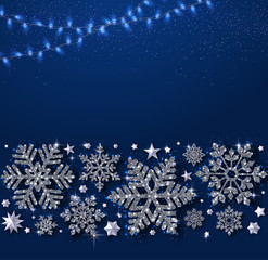 Blue Christmas, New Year and winter background with shiny snowflakes and garland of lights.