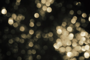 Christmas abstract gold mix black bokeh background with light color in blur.
