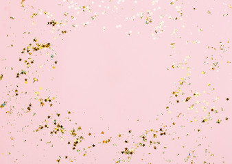 Pink confetti and stars and sparkles on pink background. Wall mural