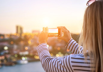 Happy blonde woman - tourist shot on her smartphone camera beauty